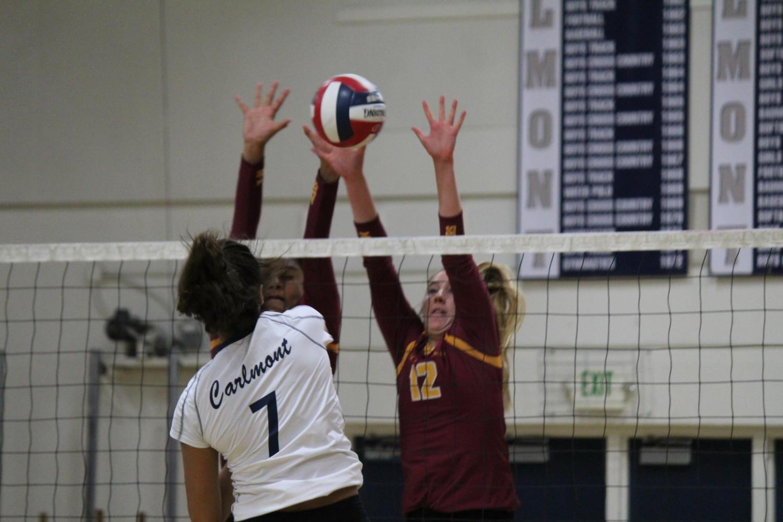 Sophomore Alisha Mitha spikes the ball against the Bears.
