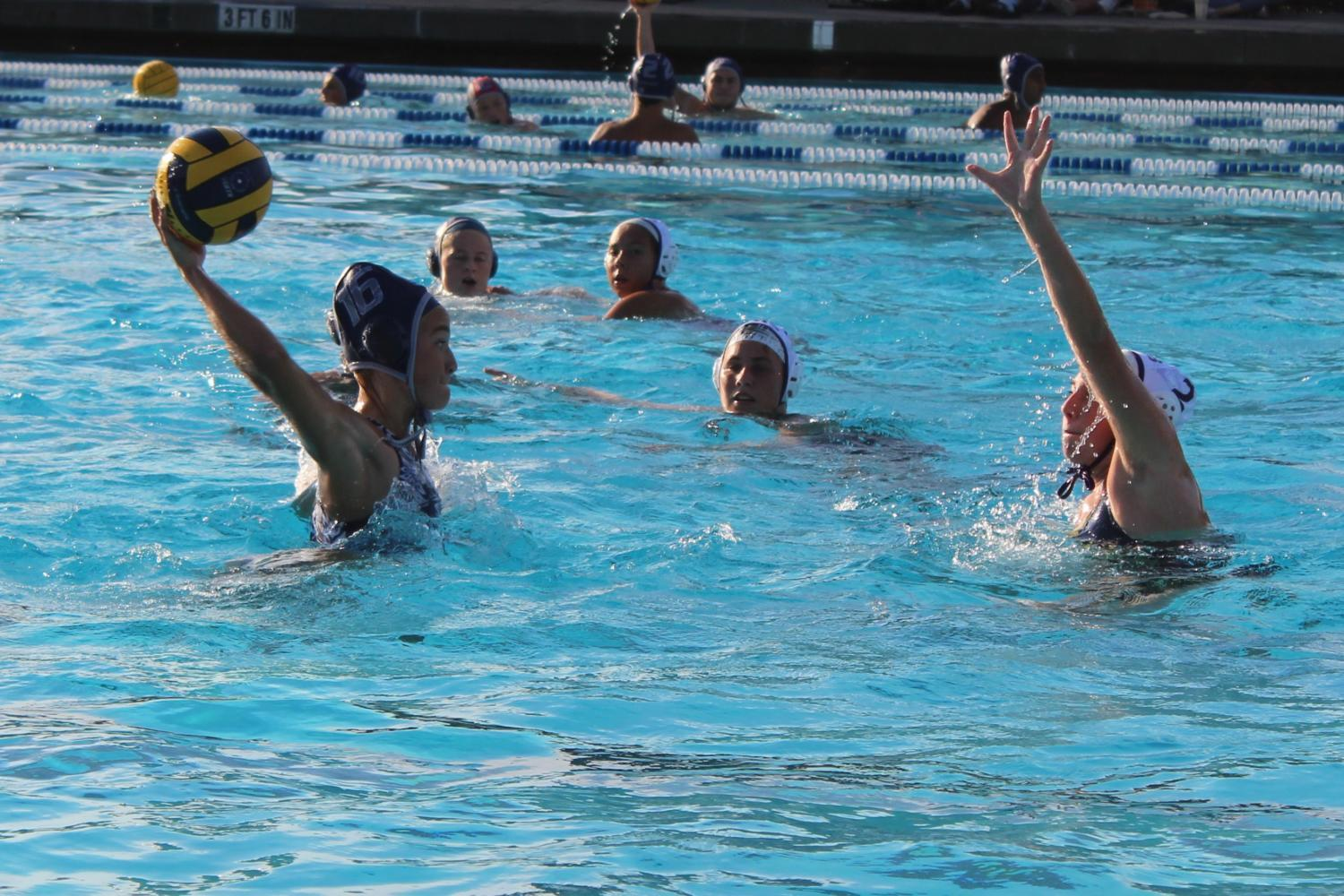 Ciera Stratton, a senior, throws the ball down the pool to score a goal for the Scots.