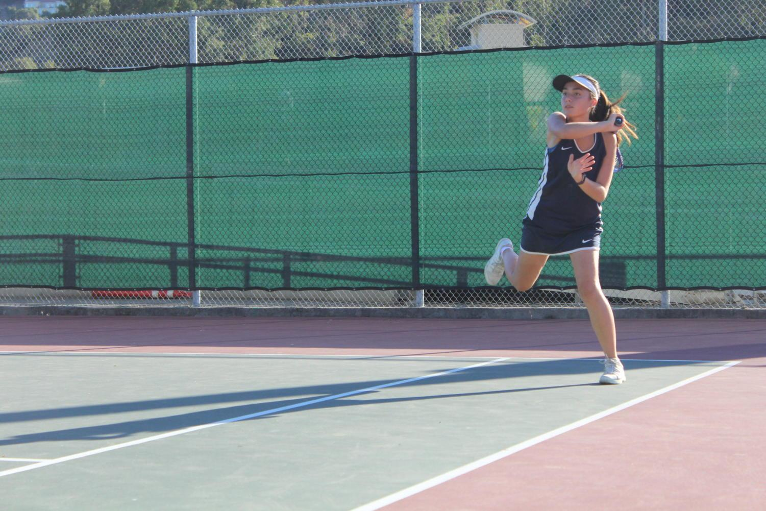 Sophomore Lily Gittoes returns a shot from the Hillsdale team during her doubles match.