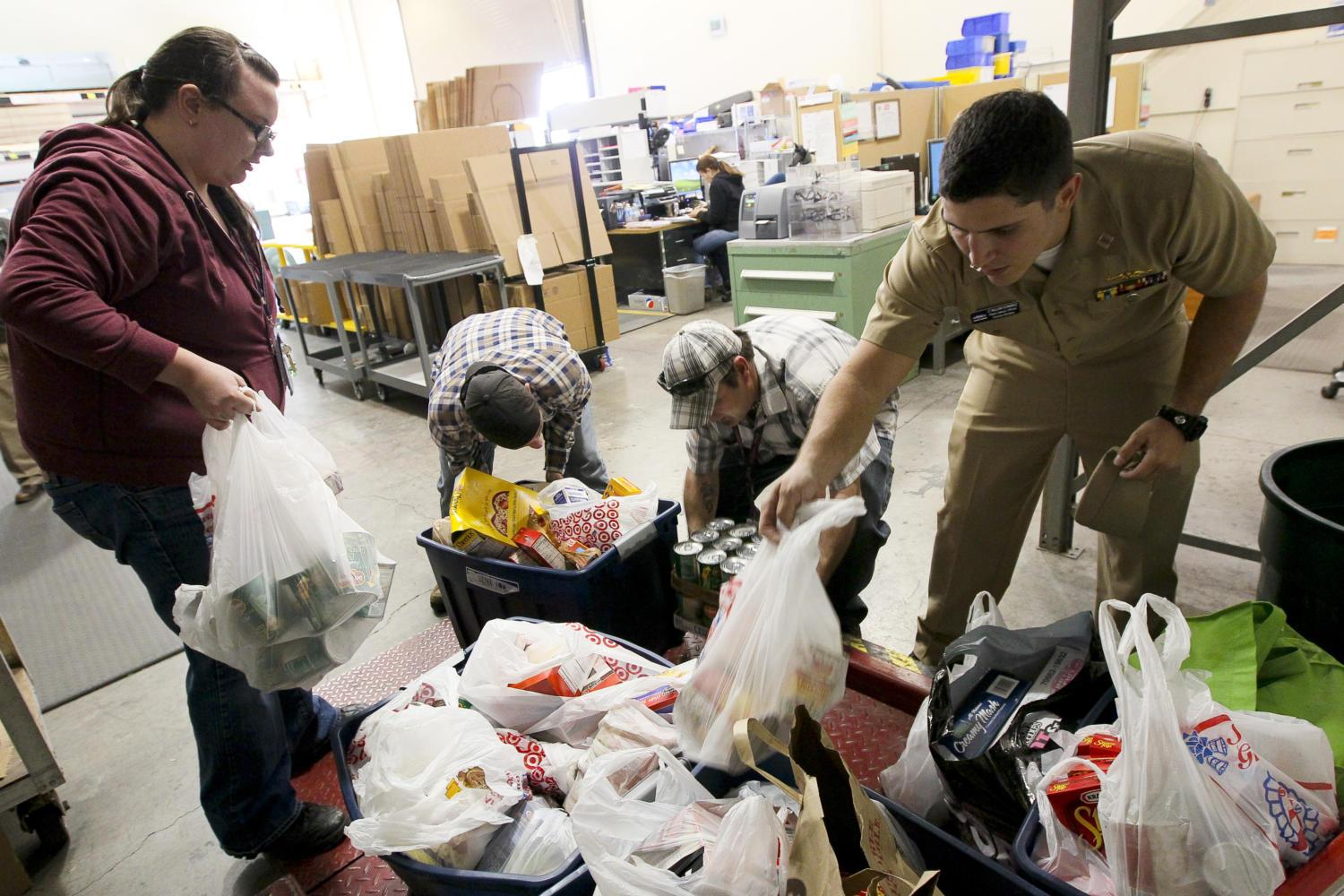 Food drive donations, like these for the Thanksgiving US Navy food drive, can make a big impact but can also overwhelm charities.