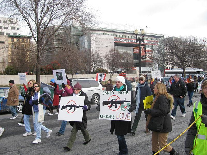 Protesters+marching+to+fight+for+stricter+gun+control+after+the+Sandy+Hook+shooting+in+2013.