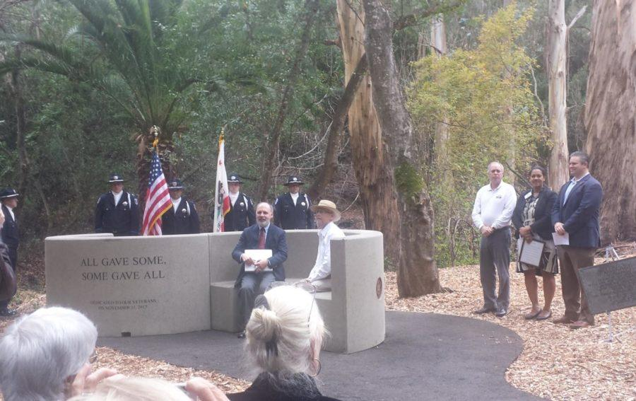 Retired+Navy+Capt.+Randall+Ramian+and+former+Belmont+Mayor+Eric+Reed+were+the+first+to+sit+on+the+new+memorial+bench.