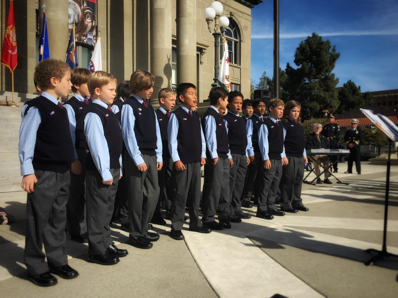 The+Ragazzi+Boys+Choir+sings+%22God+Bless+America%22+as+their+audience+sings+along.