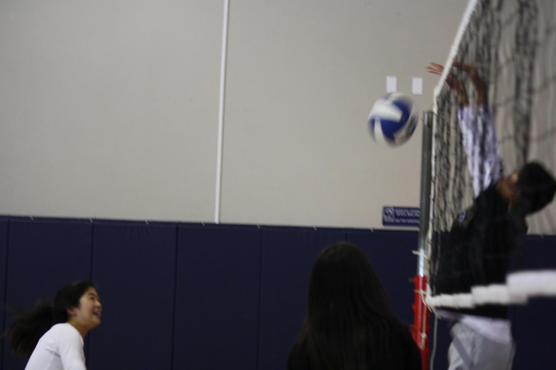 Freshman Hannah Wu getting blocked by Kyle Lau, a sophomore.