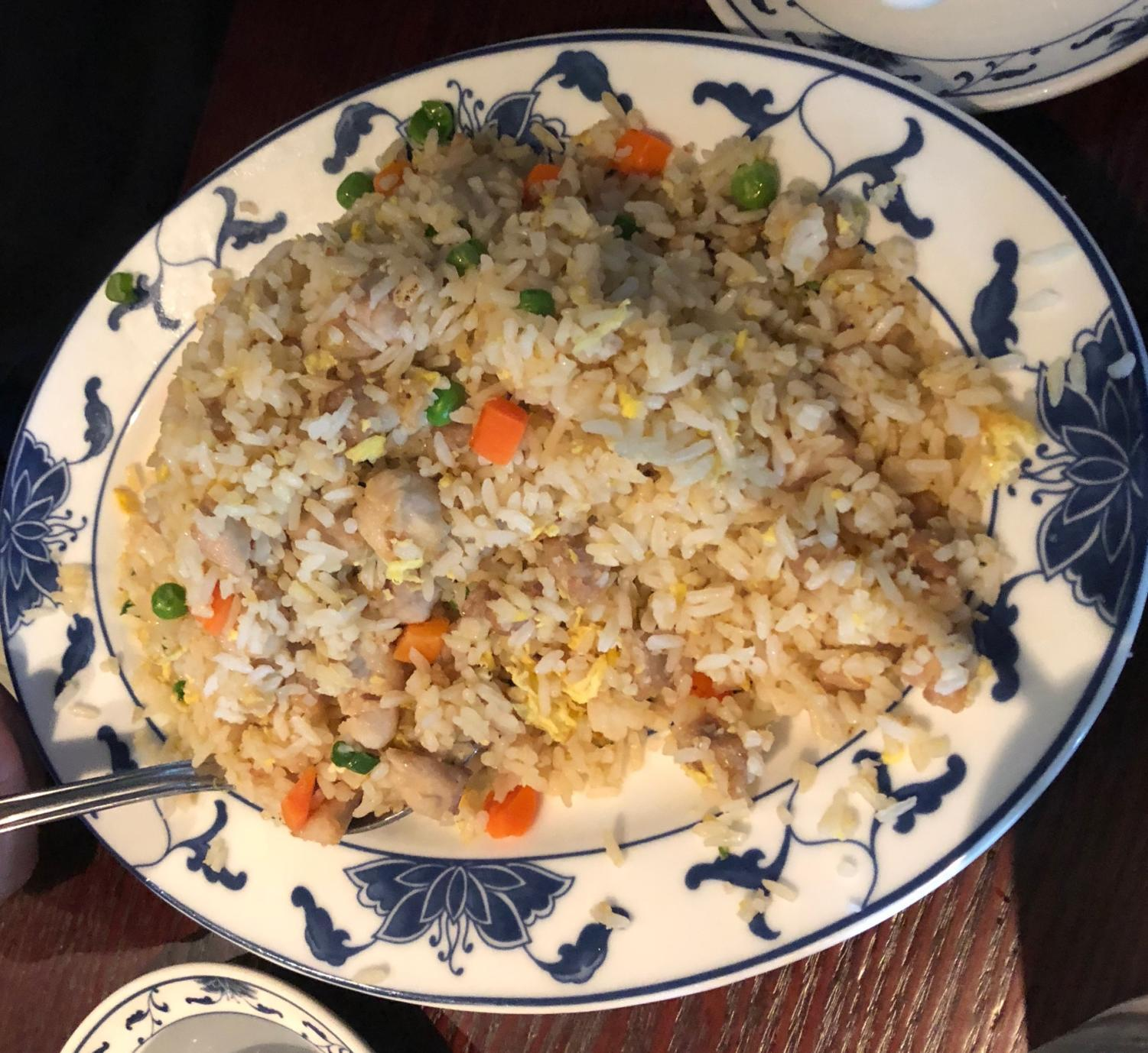 Gin Mon's chicken fried rice: a stir fried mix of peas, egg, chicken, carrot, and rice.