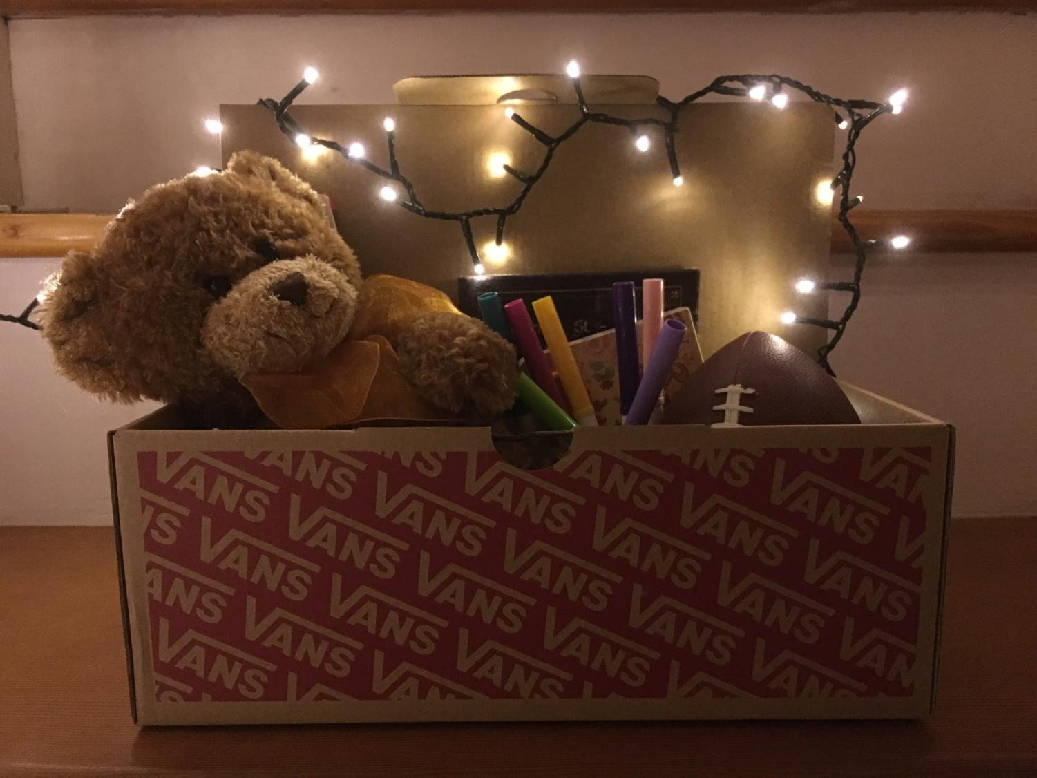 A shoebox filled with treats bring happiness to children in need during the holiday season.