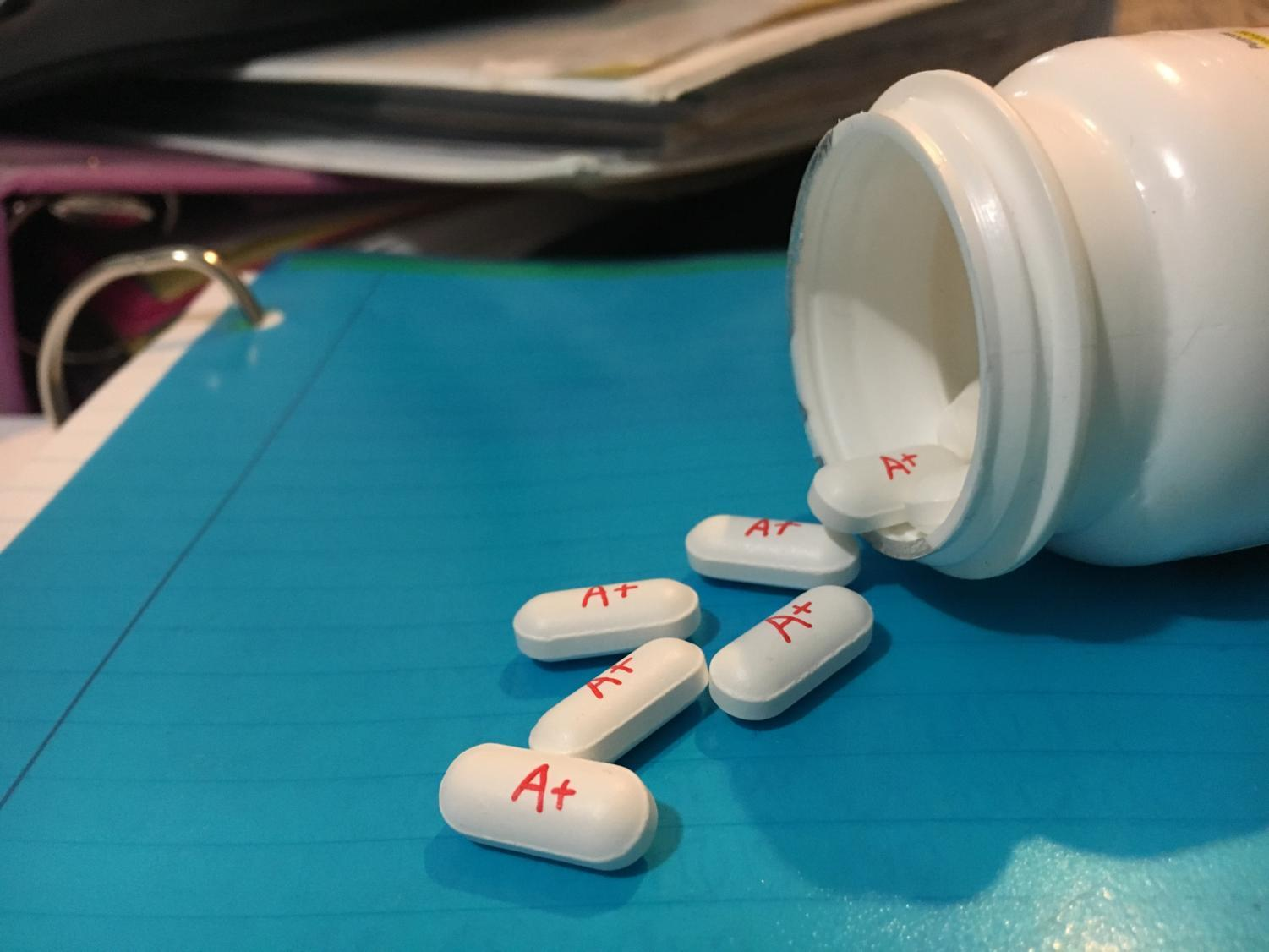 Many students will do whatever they can to receive a good grade. The A+ pills represent the addictive side of this craving, which many students face.