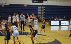 Varsity girls' basketball takes the win against the Gunn Titans