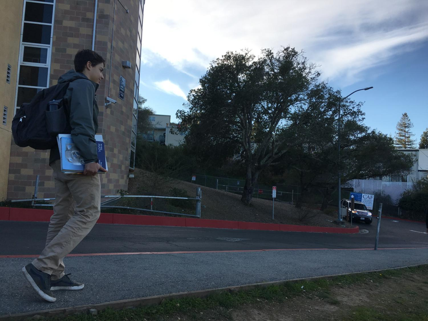 Tomas Ronderos, a sophomore, walks from Carlmont High School with textbooks in hand, ready to prepare for the SAT and future successes.