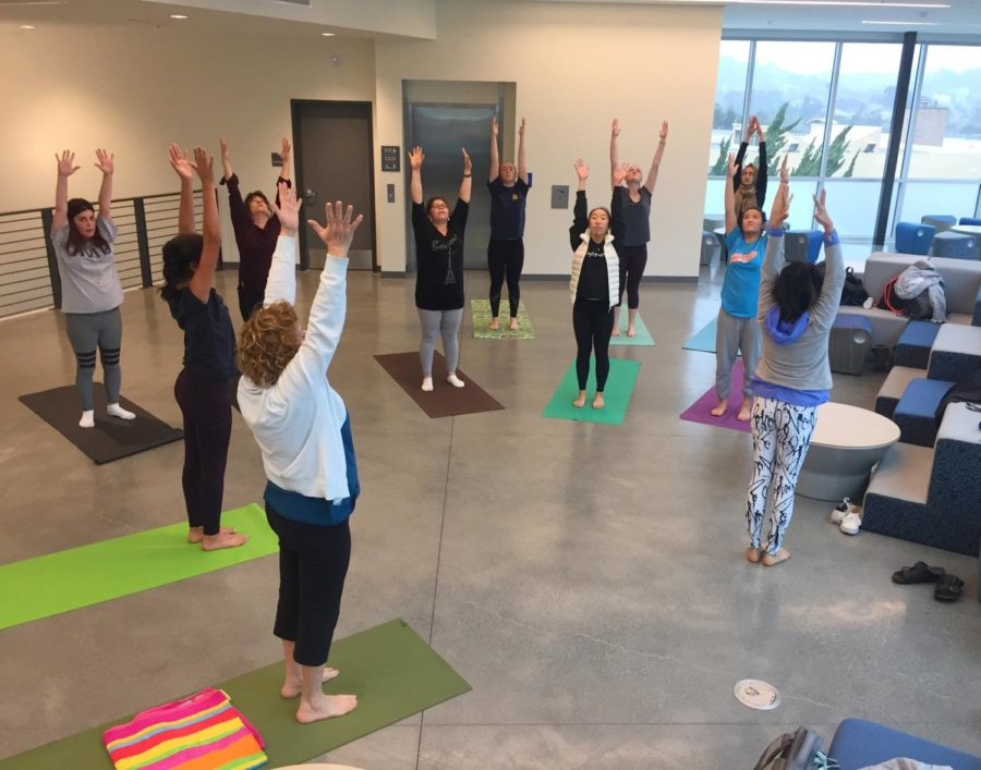 Yoga+Club+members+gather+in+the+lobby+of+the+S-wing+to+participate+in+an+hour-long+yoga+session+led+by+a+professional+yoga+instructor.