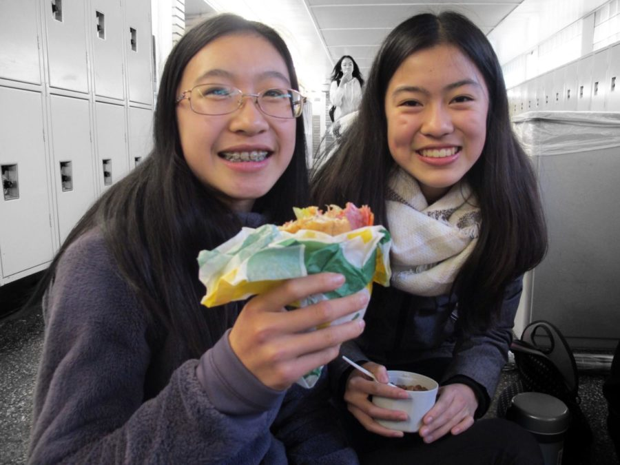 Freshman+Valerie+Kuo+enjoys+lunch+via+a+Subway+sandwich+with+her+friend+Vienna+Huang.