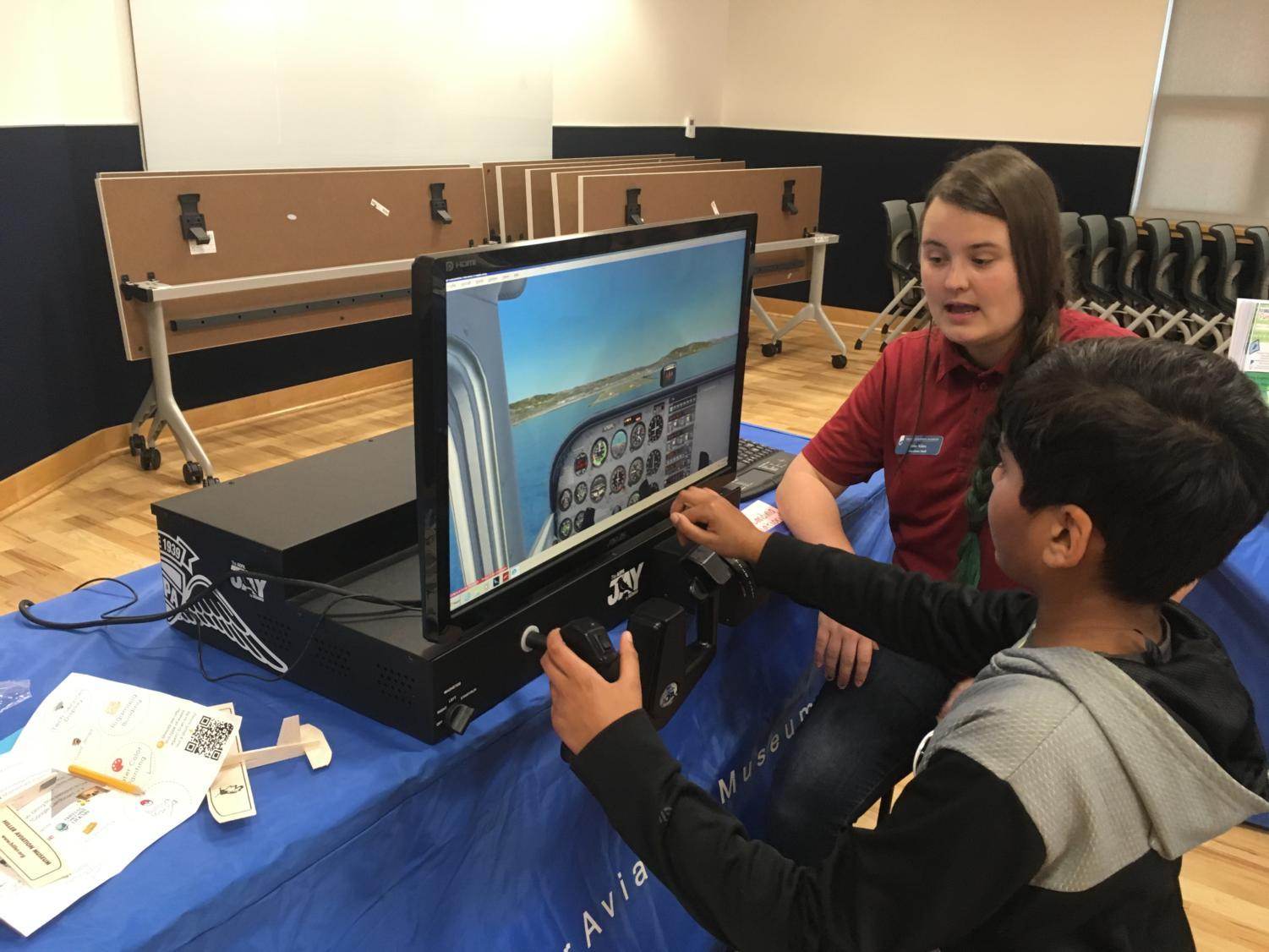 Kids+attempt+to+land+a+plane+in+the+Hiller+Aviation+Museum%27s+flight+simulator.