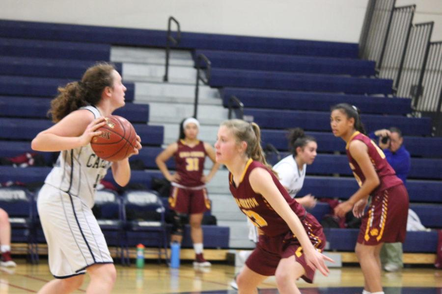 Sophomore+Samantha+Lombardi+looks+for+people+to+pass+to+while+keeping+the+ball+away+from+the+defender.