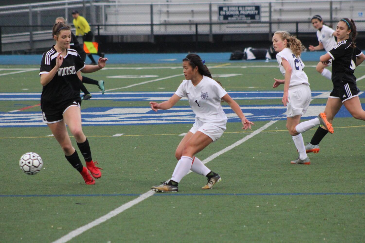 Samantha Phan, a junior, fights for the ball with hopes of scoring for the Scots.
