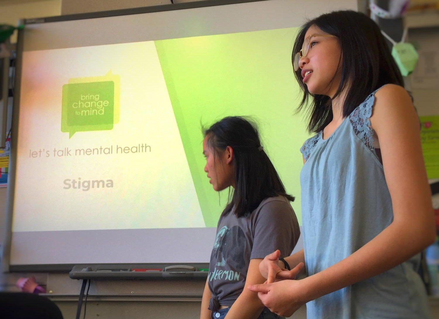 BC2M Club President Mackenzi Rauls and Vice President Emma Lee give a presentation about mental illness to their club members during one of their Tuesday lunch meetings in room C14.