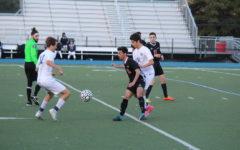 Varsity boys' soccer ties Woodside in a thriller on senior night