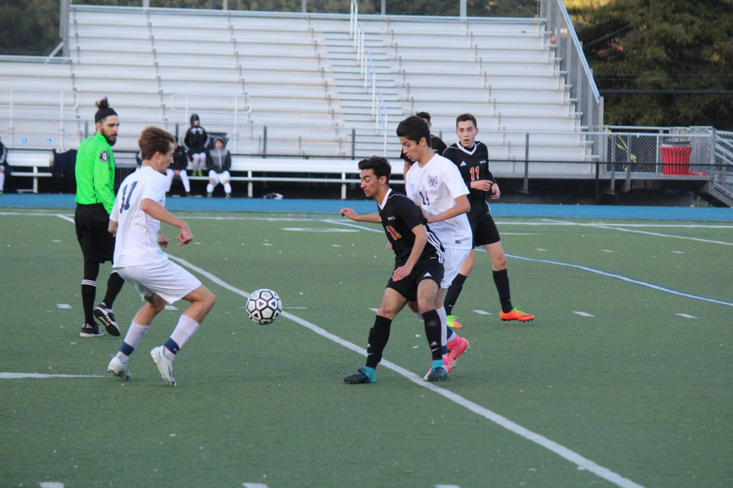 Defender Antonio Barba steals the ball away from Woodside forward.