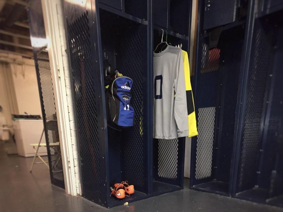 The+team+room+is+used+by+the+varsity+boys+soccer+team+during+the+winter+season.+Players+leave+their+gear+in+their+specific+locker.+Muaath+Nofal%2C+a+senior+on+the+soccer+team%2C+said%3A+%22Basically%2C+we+keep+our+jerseys+in+there+and%2C+each+weekend%2C+Coach+Will+Stambaugh+washes+them+for+us.%22