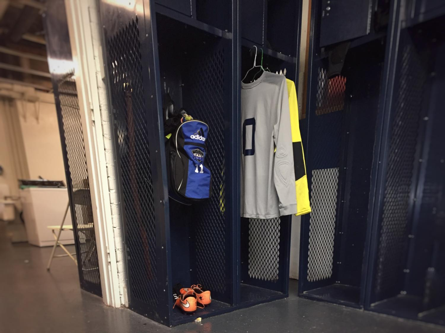The team room is used by the varsity boys soccer team during the winter season. Players leave their gear in their specific locker. Muaath Nofal, a senior on the soccer team, said: