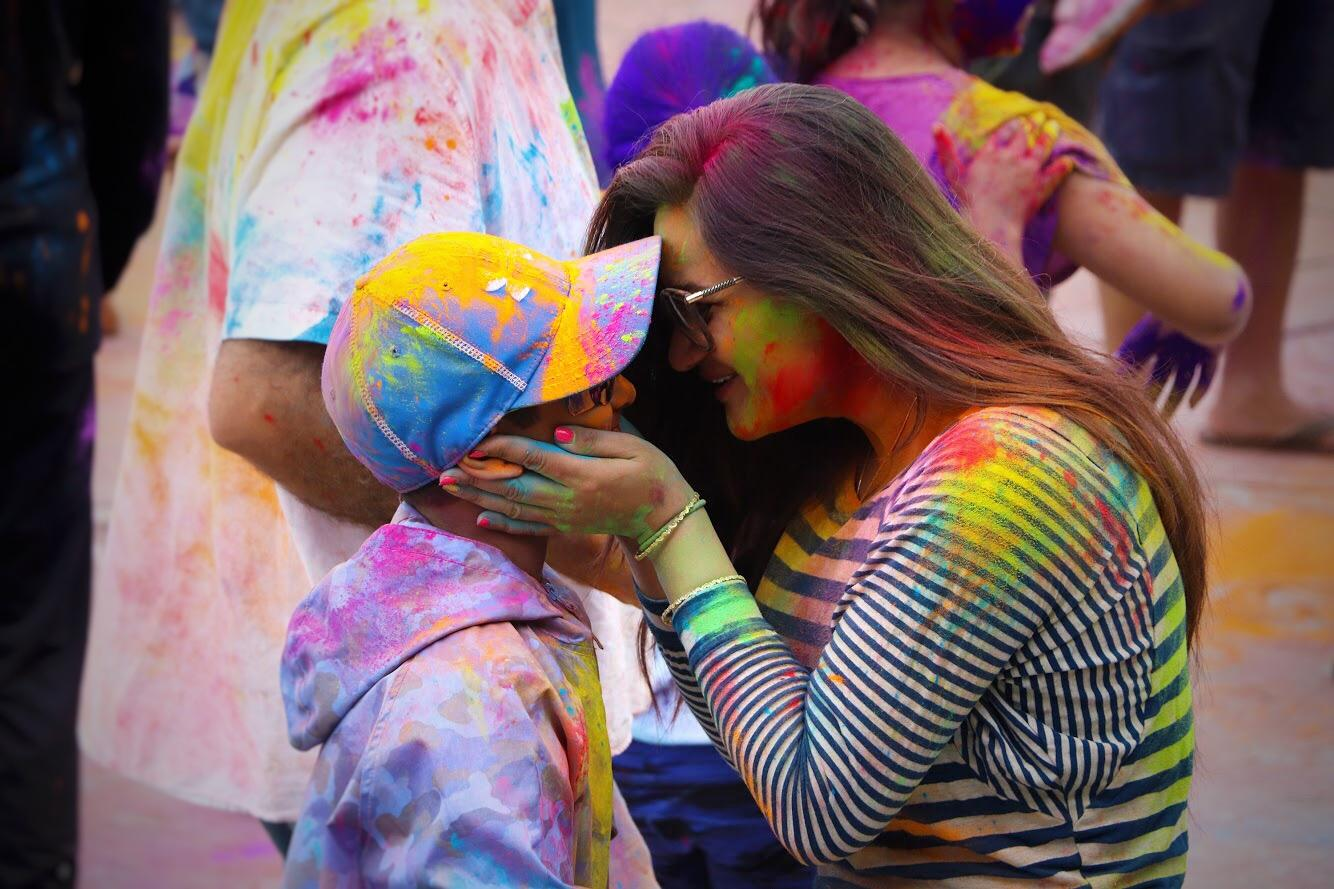 A mother and child share a moment as they celebrate Holi, the Hindu festival of colors, in Foster City on March 10. As revelers threw and smeared brightly colored powder onto each other, they commemorated the beginning of spring and the triumph of good versus evil.
