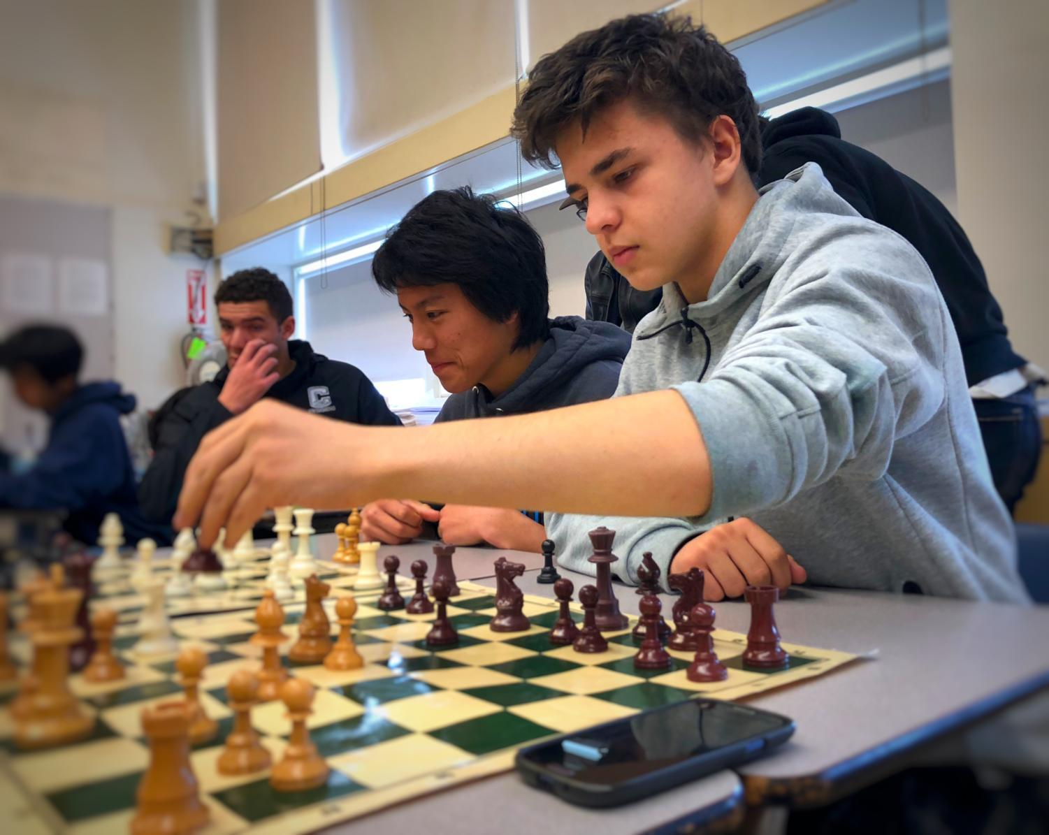 Junior Andrey Shapiro plays in a chess match with his peer during one of Chess Club's regular Friday lunch meetings in D10.