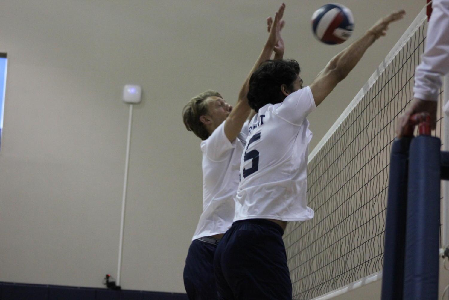 Haider+and+Bouchard+block+a+spike+against+the+Vikings.+