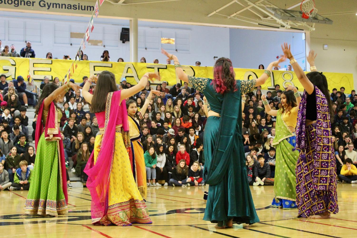 Indian Club dances wearing traditional Indian lenghas.