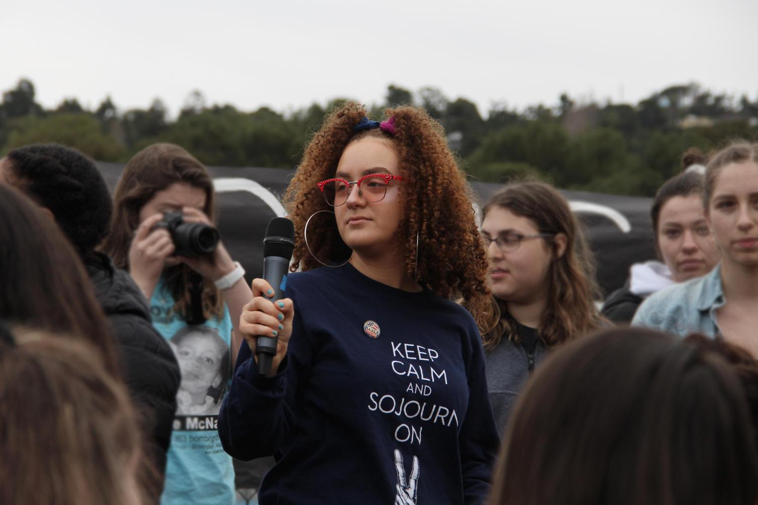 Hundreds of students made their way down to the quad for 17 minutes on March 14 at 10 a.m. to stand in solidarity with Parkland, Fla. Rosie Asmar, a senior, helps to lead the rally by singing songs and holding a moment of silence to honor the 17 students who were killed.