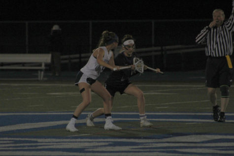 Girls' varsity lacrosse defeated by Sequoia in a close game