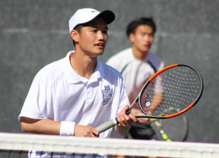 Carlmont+junior+Jerry+Liu+waits+to+receive+a+serve+with+his+partner%2C+senior+captain+Kevin+Xiang.+