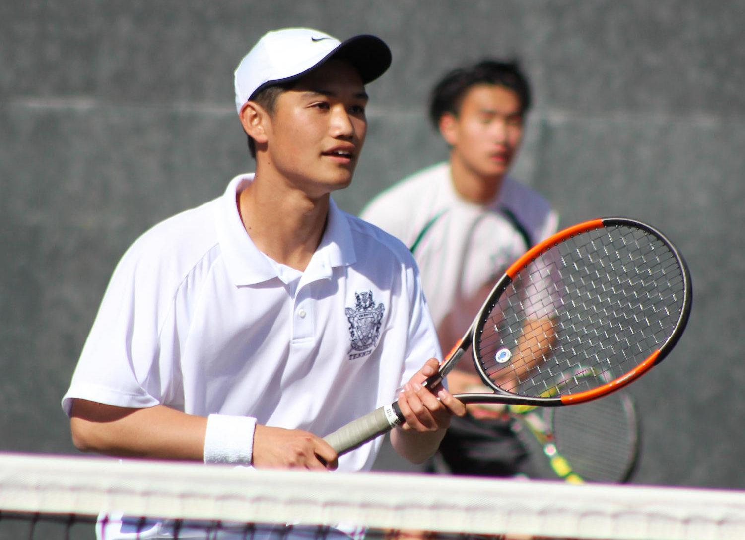 Carlmont junior Jerry Liu waits to receive a serve with his partner, senior captain Kevin Xiang.