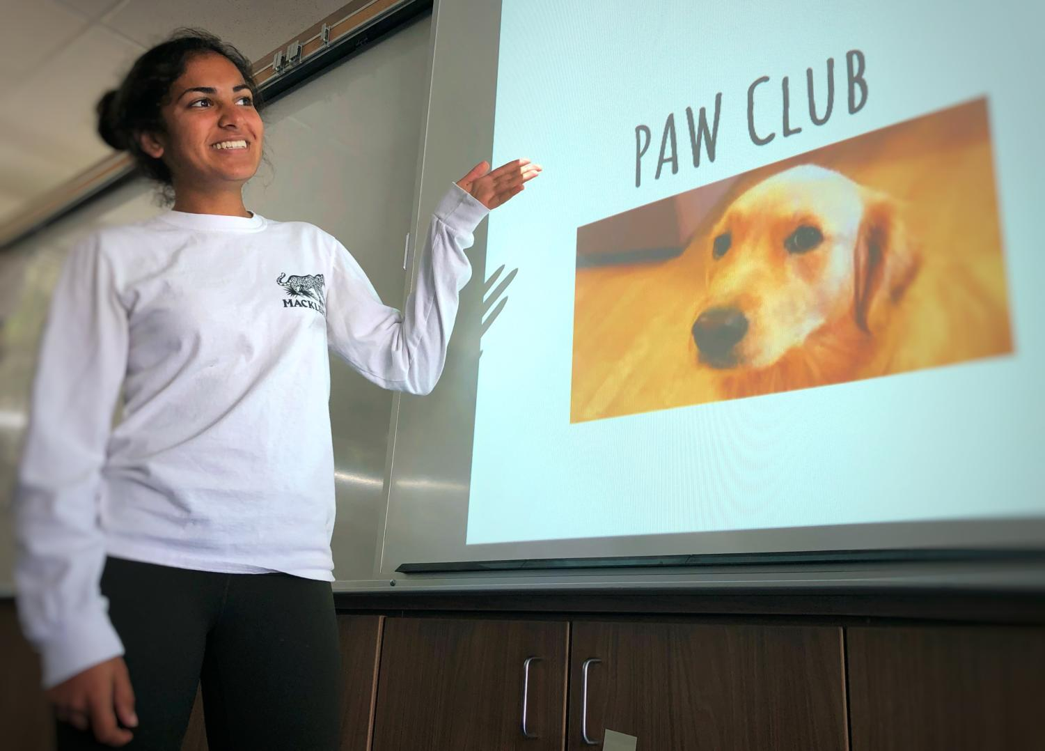 PAW Club President Soni Kanaya informs her club members about upcoming events during their regular Wednesday lunch meeting held in room S23.