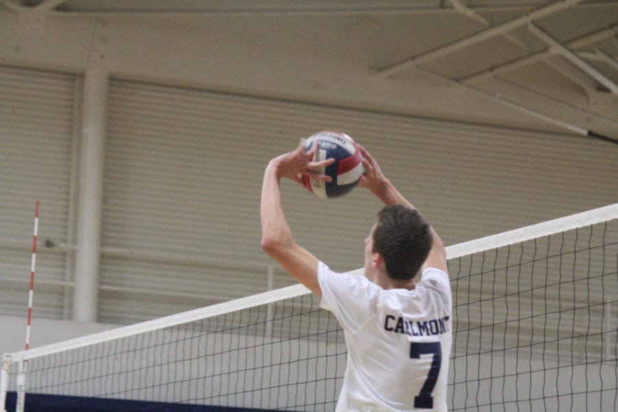 Jonah+Przybyszewski%2C+a+senior%2C+sets+his+outside+hitter+in+hopes+to+get+a+kill.