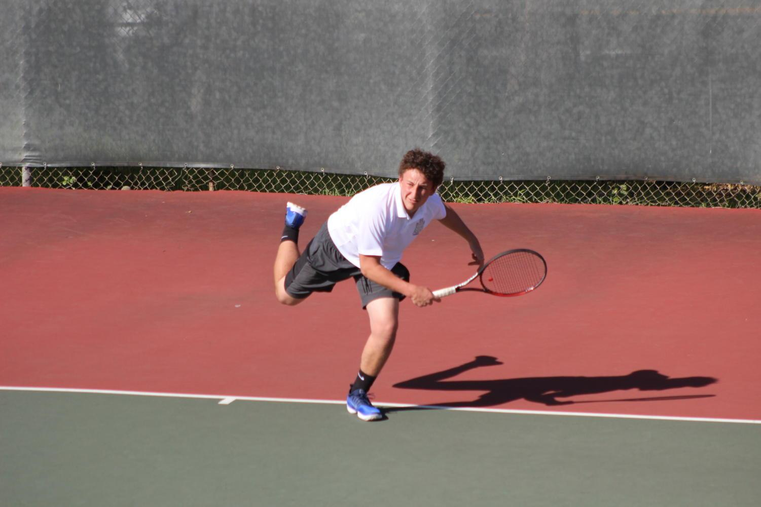 Sophomore Ben Barde serves the ball in his match against Woodside.
