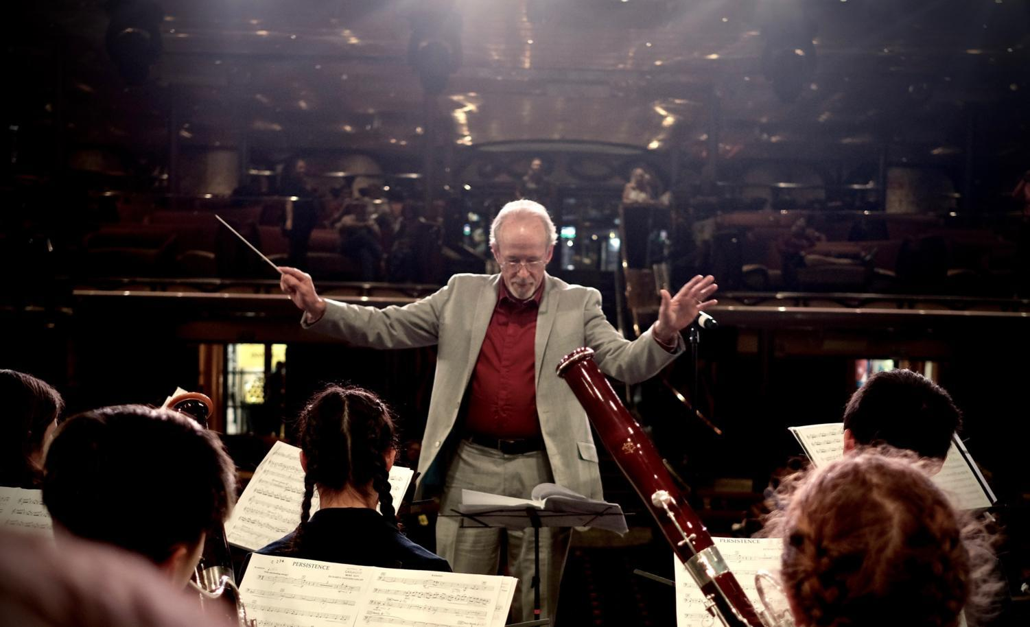 Rory Snyder conducts Symphony Orchestra on board the cruise ship.