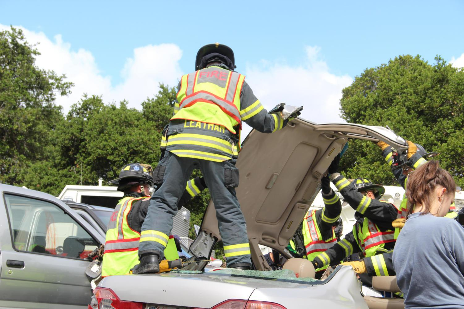 The+fire+department+removes+the+top+of+one+of+the+cars+in+order+to+retrieve+the+students+trapped+inside.