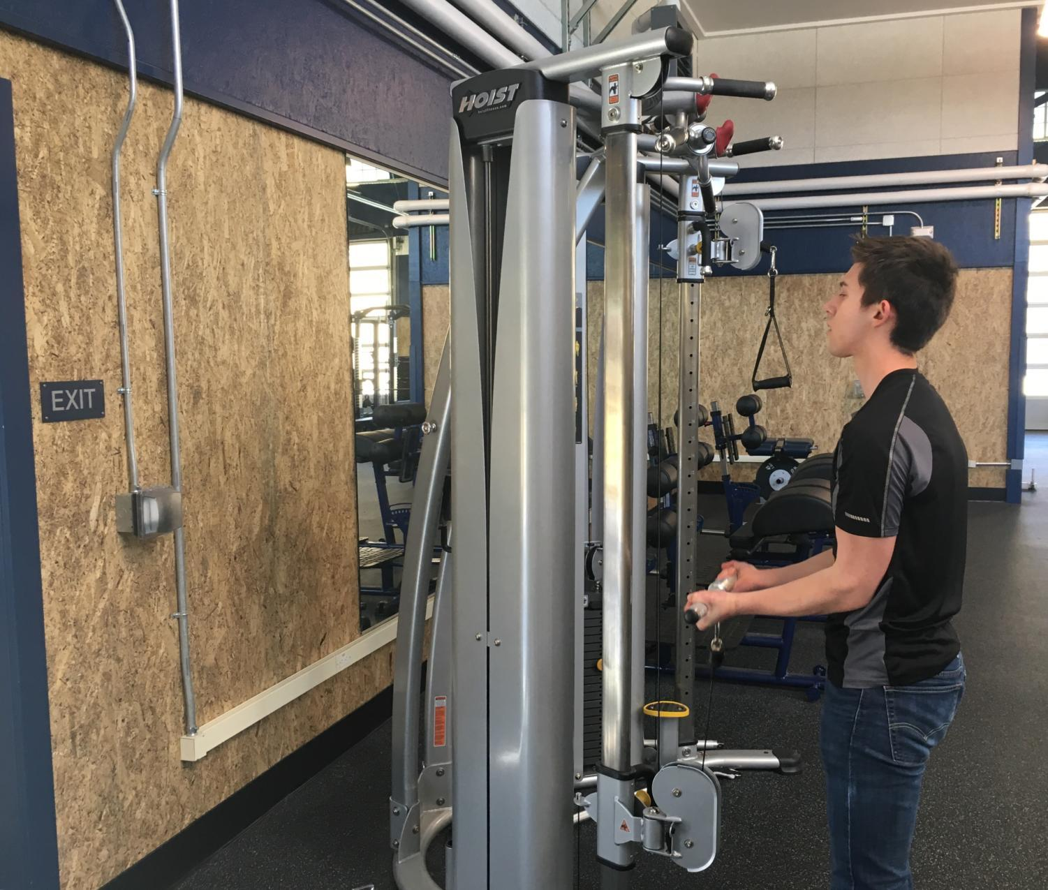 Ethan Stroh, a senior in Weight Training Club, works out in the Carlmont weight room.