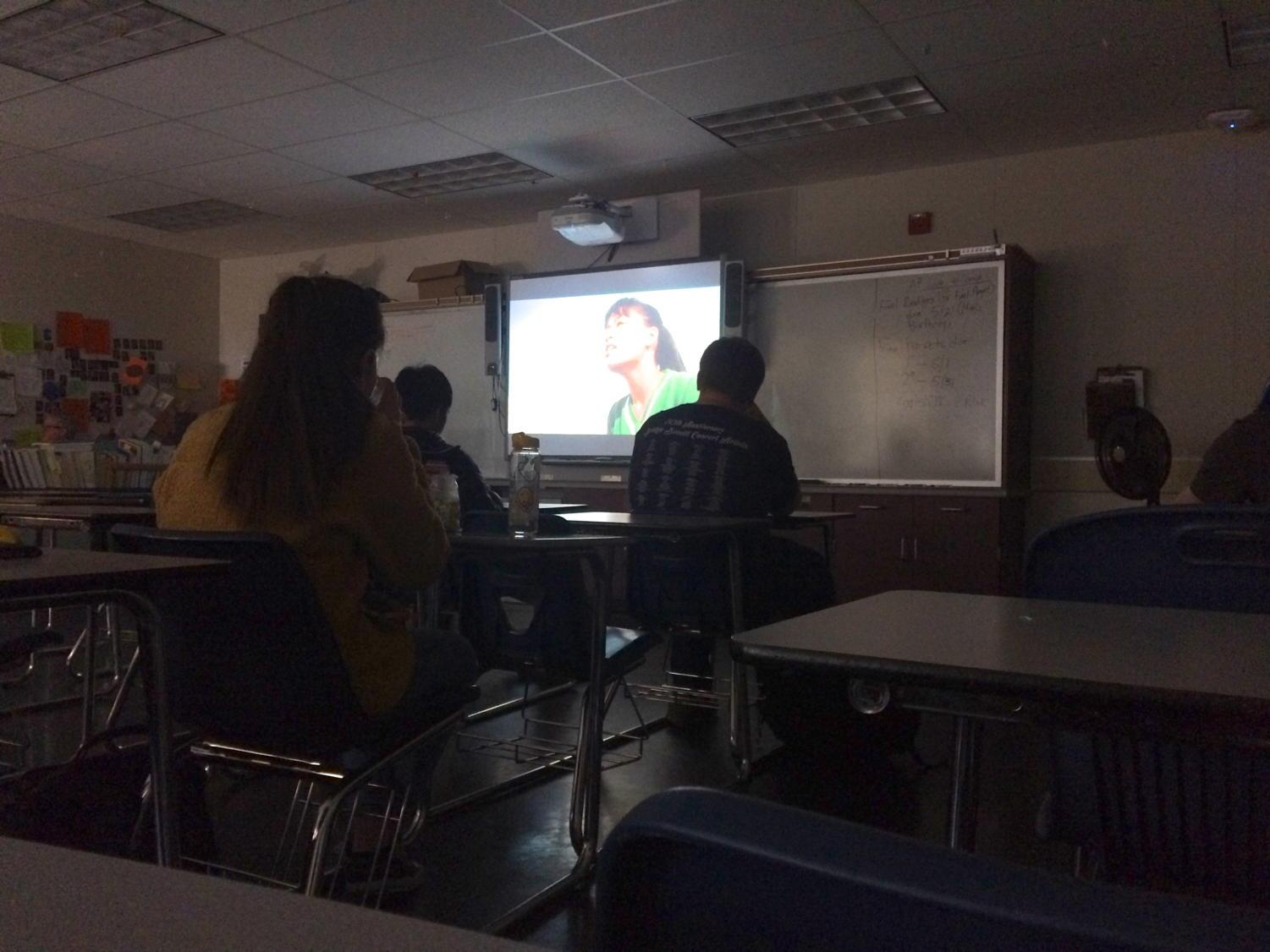 Members of Classic Films club watch a movie during lunch.