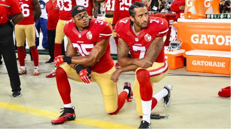 Eric+Reid+and+Colin+Kaepernick+kneel+before+a+game+in+2016.