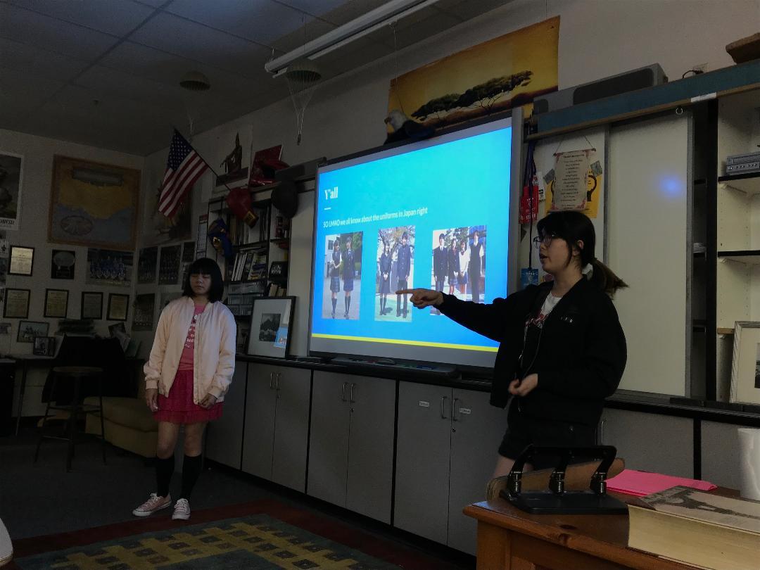 J-Pop club members present about school uniforms in one of their meetings.