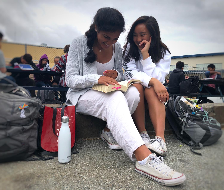 Juniors Soni Kanaya and Chloe Palarca-Wong eat lunch in their all white Spirit Week gear.