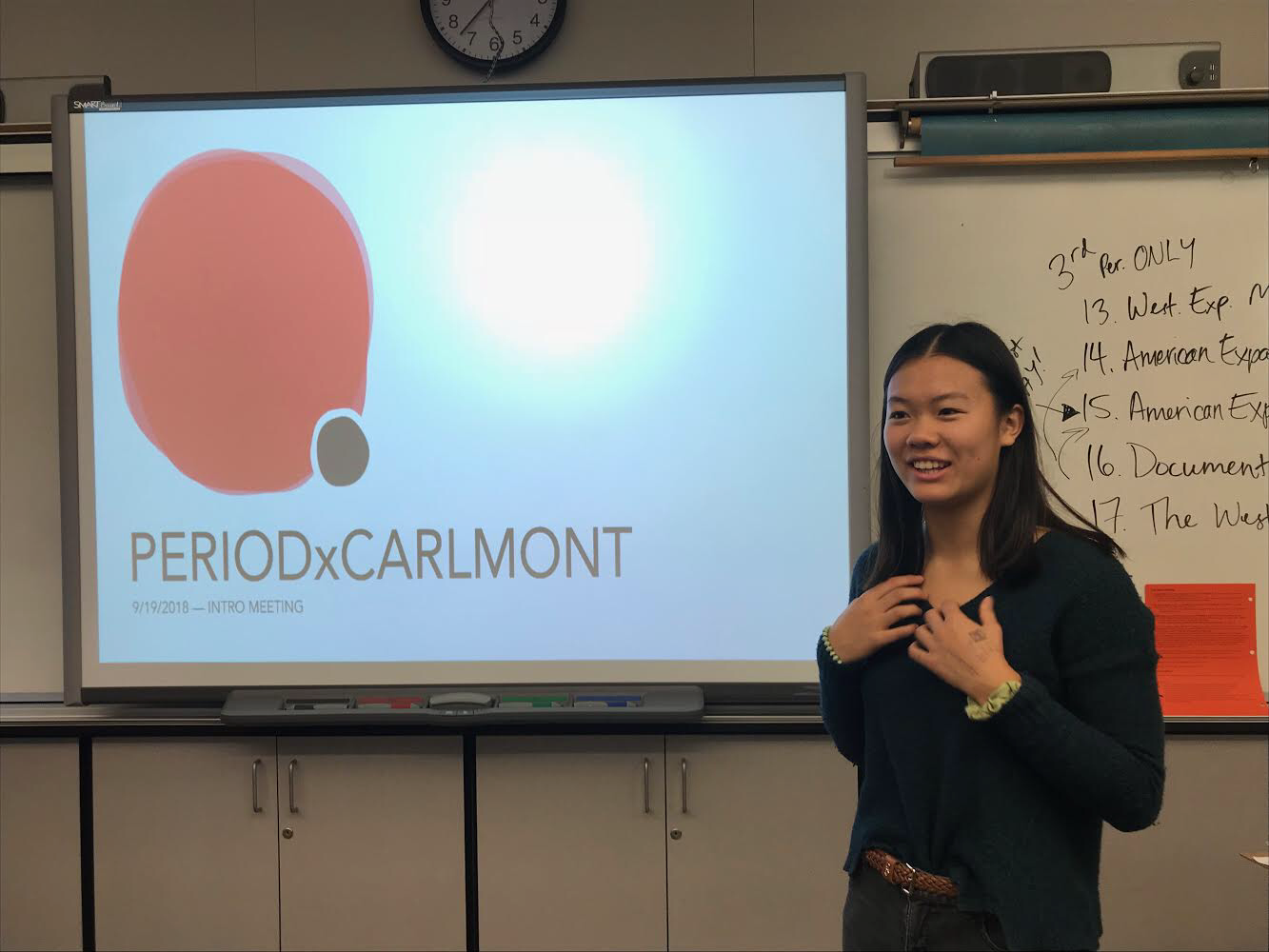 Chloe Wen, a senior, gives a presentation about PERIOD at the club's first meeting of the year.