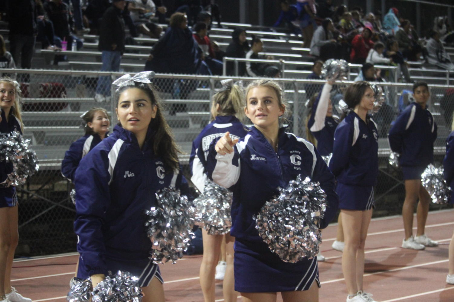 Cheerleaders+watch+as+Julian+Morin%2C+a+senior%2C+scores+the+second+touchdown+of+the+night.