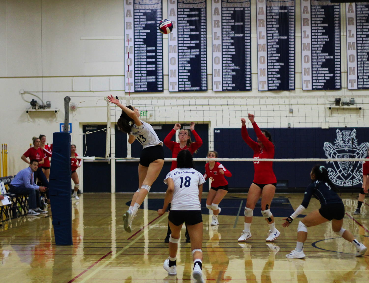 Sophomore Leah McMillen jumps to get a kill against the Burlingame Panthers.