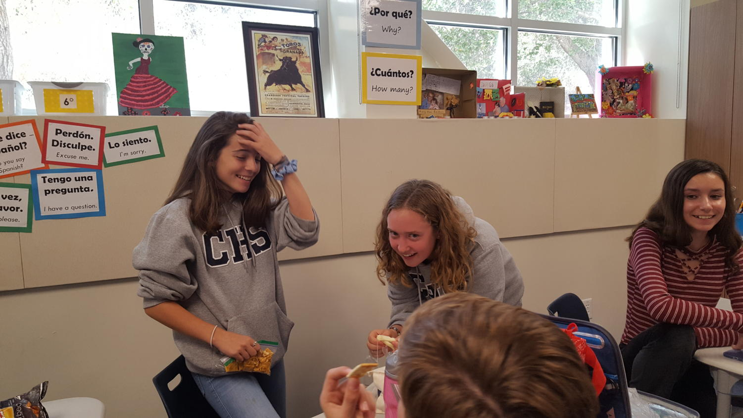 Freshmen, Isabella Peterson (left), and Tori Balsam-Ashling (right), laugh about an old song that was being played.