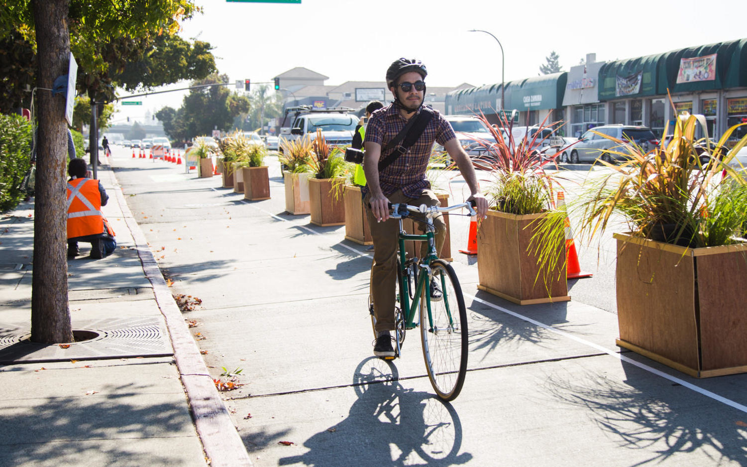 A bikers uses the new protected bike lane on El Camino Real during the test run on Oct. 20.