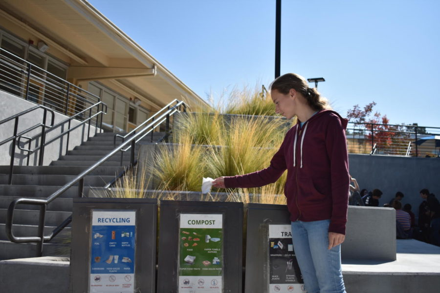 Alice+Chamberlin%2C+a+junior%2C+uses+the+tri-bins+to+throw+her+thrash+away.+With+the+tri-bins+now+on+campus%2C+many+students+are+eager+to+throw+their+trash+away+in+the+correct+spot.