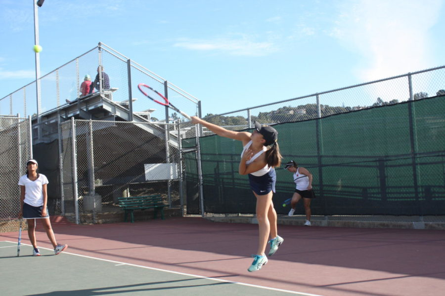 Isabella+Reeves%2C+a+sophomore%2C+serves+the+ball+during+her+warm-ups.