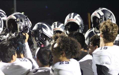 Varsity football keeps playoff dream alive