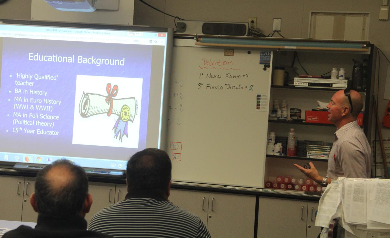 History+teacher+Jayson+Waller+explains+his+educational+background+to+parents.